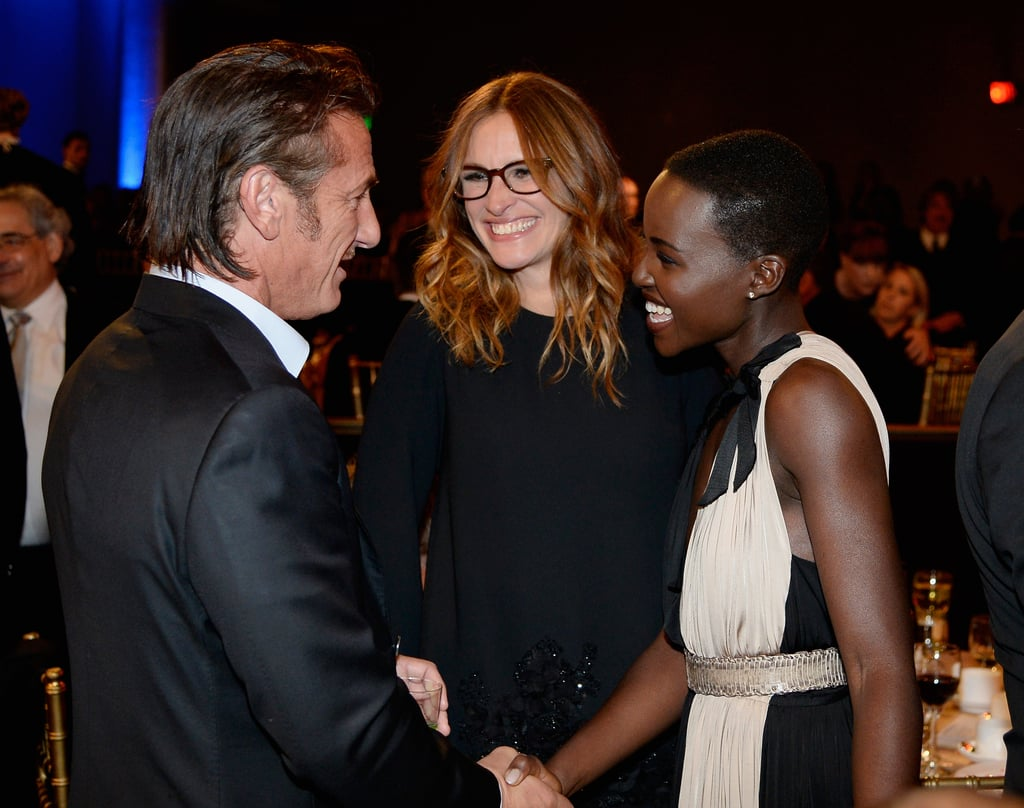 Sean Penn greeted Lupita Nyong'o during the event, while Julia Roberts looked on.