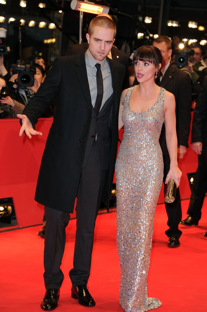 Rob and Christina had a chat while walking the carpet on their big night.