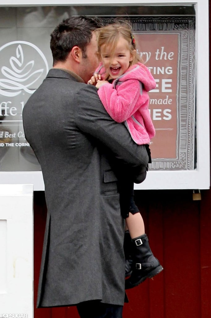Seraphina Affleck laughed as Ben Affleck carried her.