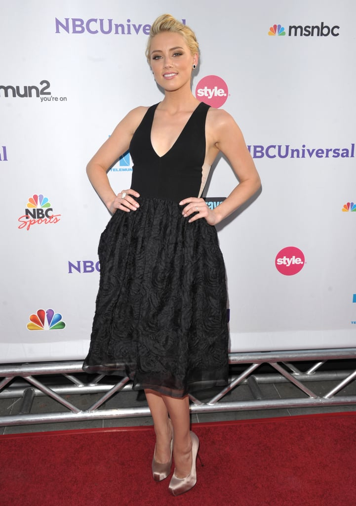 """Amber Heard first earned bombshell points in this """"Mod Marilyn"""" dress by Honor at NBC's Universal Press Tour All Star party in LA in August 2011."""