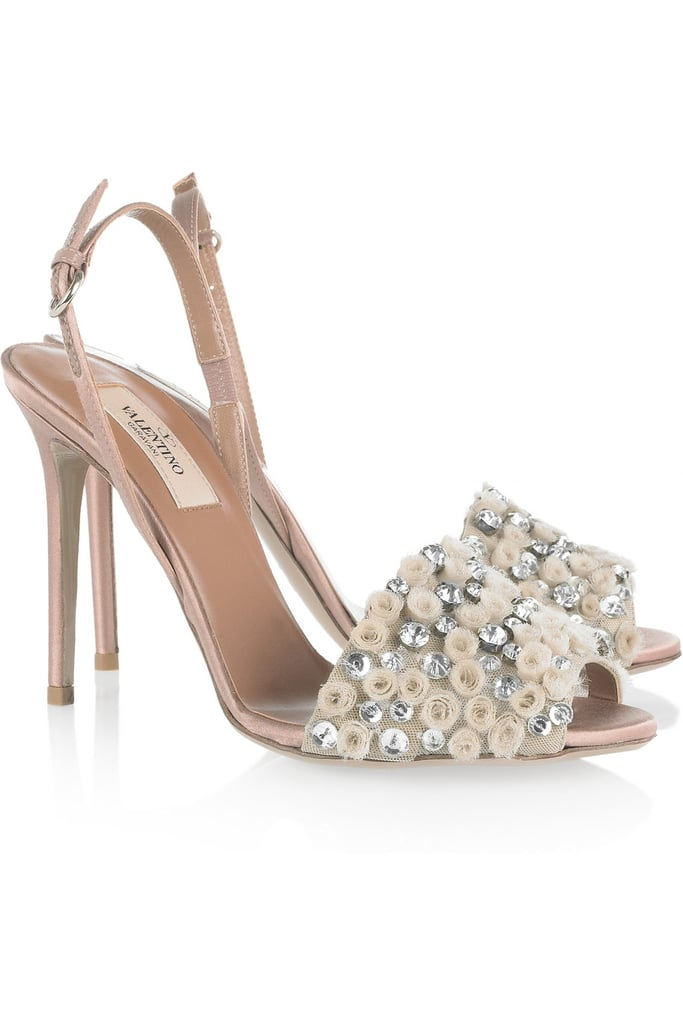 While the slingback shape is supersimple, the floral-embellished band provides a pretty accent.  Valentino Crystal-Embellished Satin Sandals ($995)