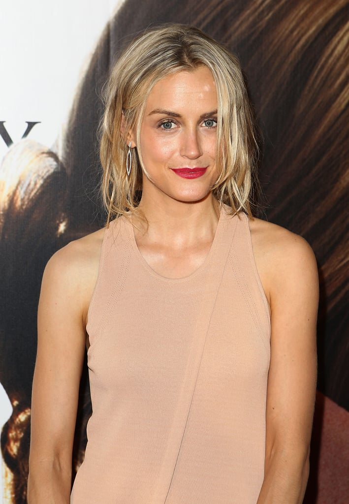 Taylor Schilling wore bright lips and a nude dress to The Lucky One premiere in Melbourne.