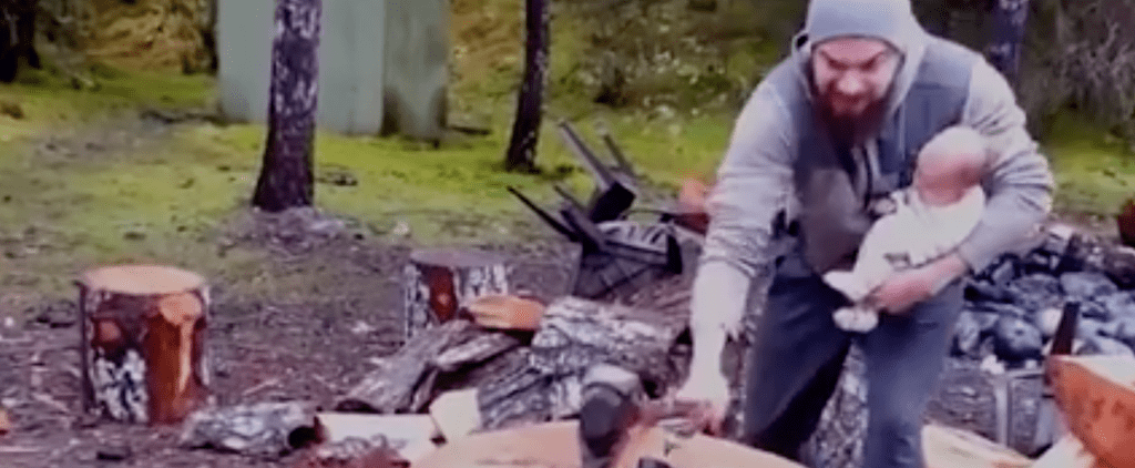 You Aren't Going to Know How to Feel After Watching This Dad Chop Wood Holding His Newborn