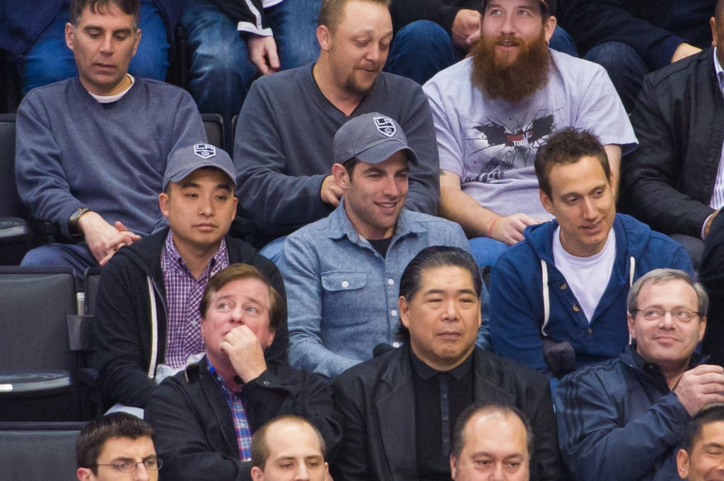 Max Greenfield sat in the stands with friends at the Kings hockey game.