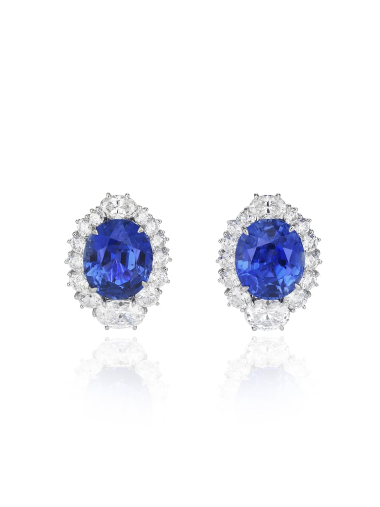 Oval-shaped sapphire earring set with oval-shaped and brilliant-cut white diamonds in 18-karat white gold. Source: Chopard