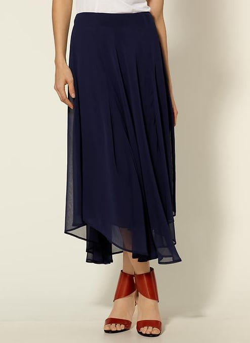 A Day-to-Night Asymmetrical Hem Skirt We're loving the look of high-low hems, but to make sure we don't err on the side of extremes, we've opted for something sleek, minimally sheer, and super flowy. Even with a white tee and cute sandals, this maxi-length skirt will work well with your warm-weather pairings. Line & Dot Chiffon Skirt ($67, originally $89)