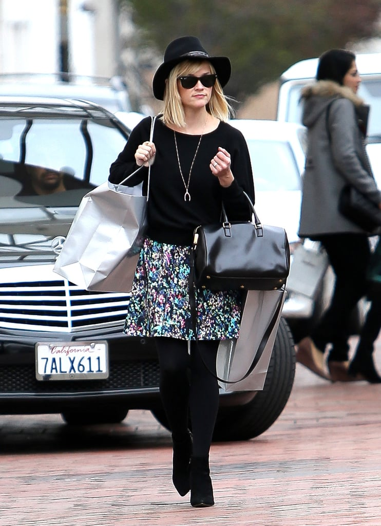 Reese broke up her all-black palette with a floral skirt while shopping in LA.