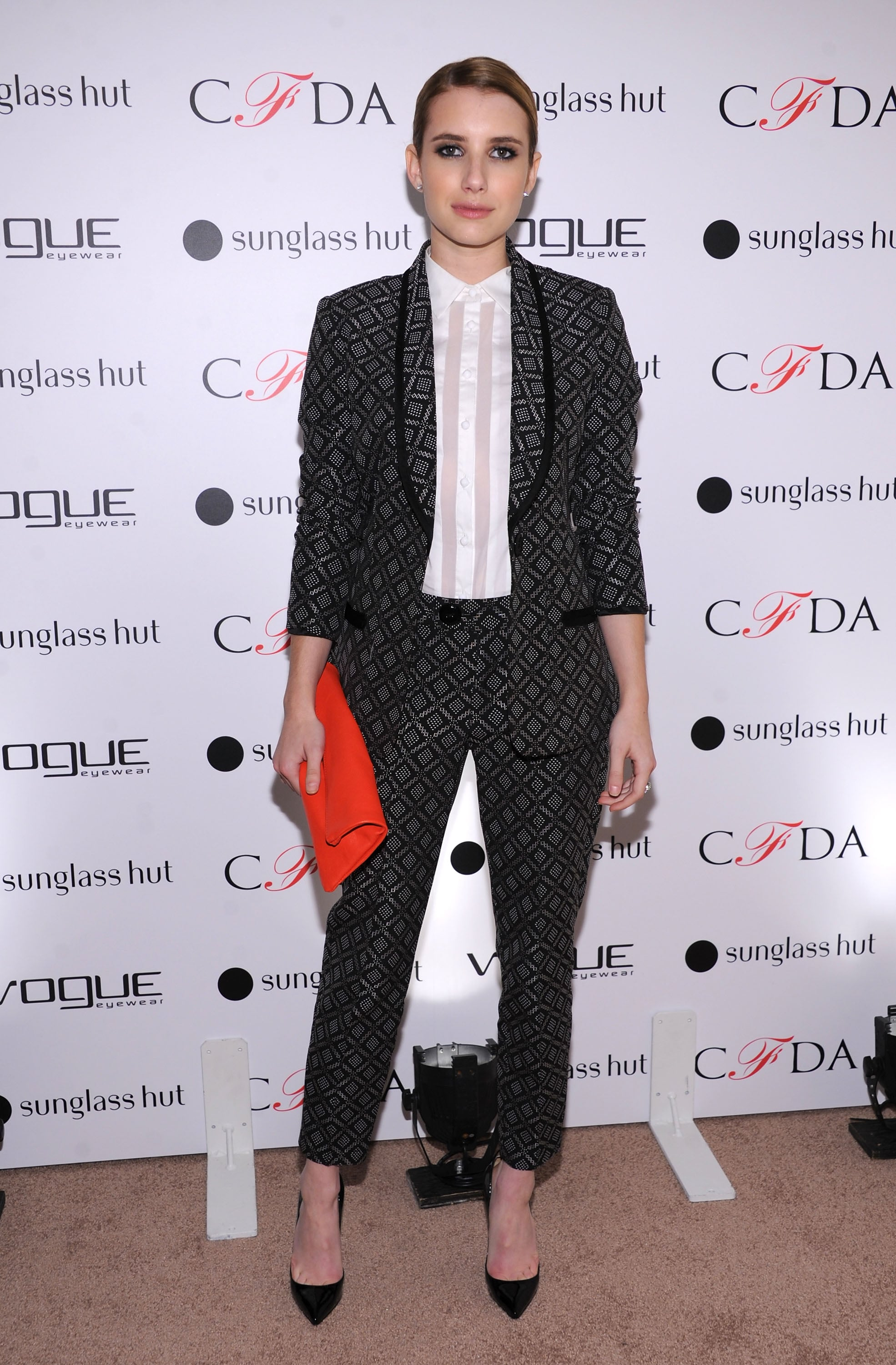 Emma sported this sleek, pulled-together Nanette Lepore printed pantsuit for the Vogue Eyewear event in October 2012.