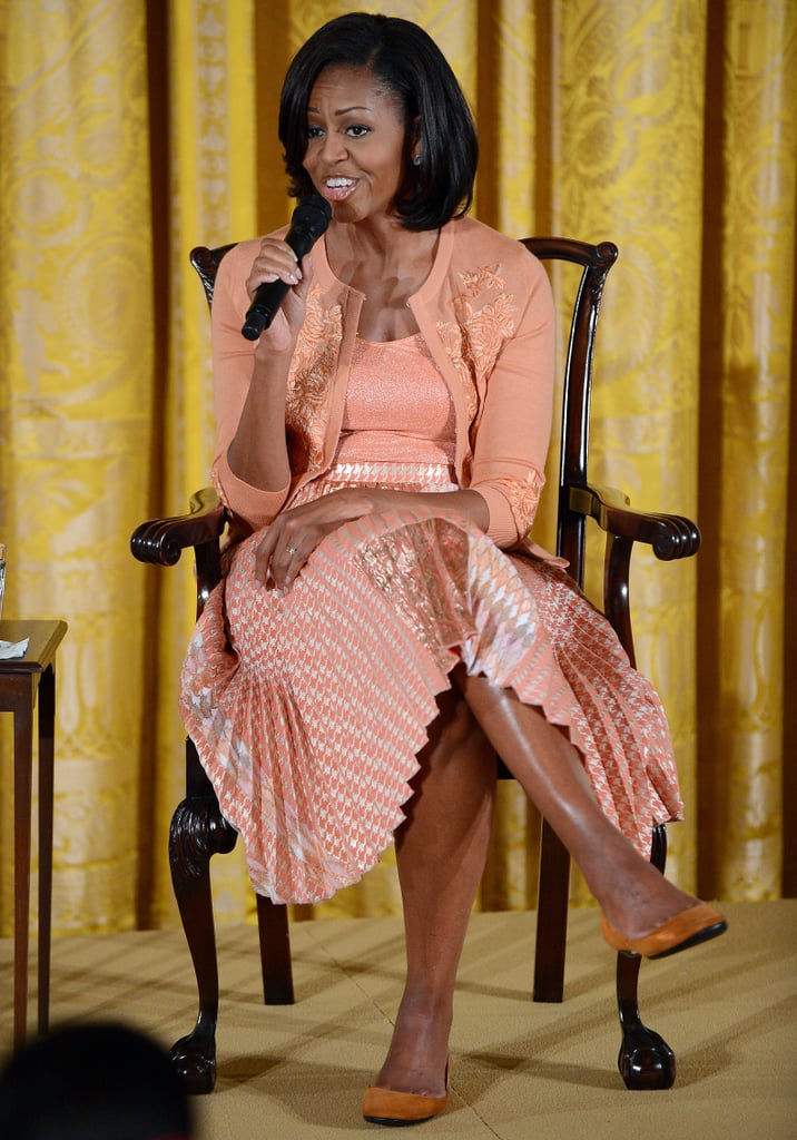 The first lady hosted an event for children in the East Room of the White House as part of Bring Your Children to Work Day in 2012. She took questions from her pint-sized guests in a salmon-hued L'Wren Scott ensemble.