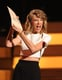 Taylor Swift looked excited while announcing a winner. She didn't take home any solo awards, though.