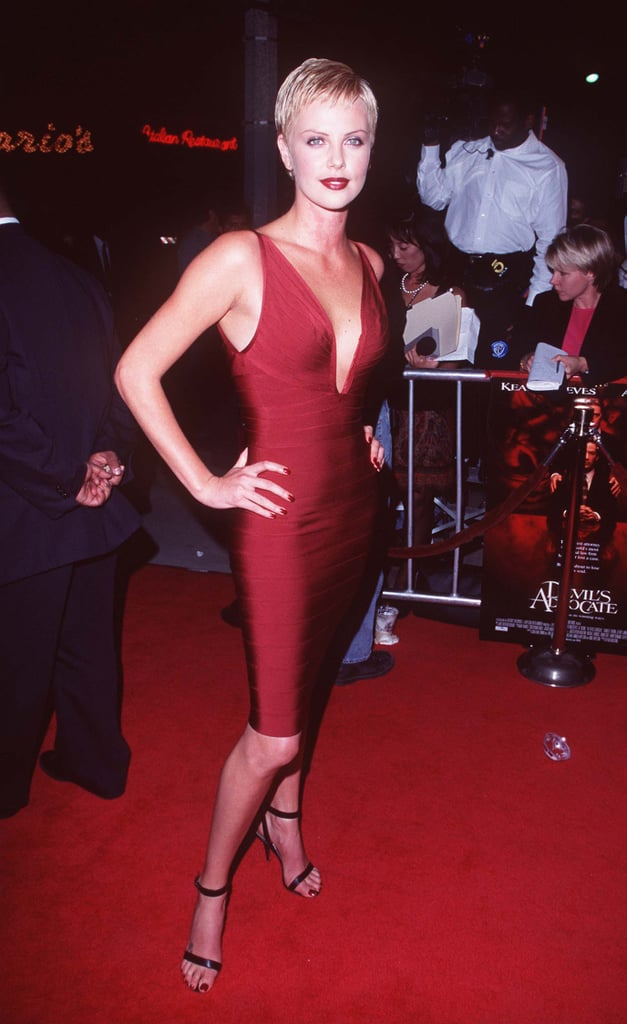 Charlize hit the October 1997 premiere of Devil's Advocate in a bandage-style red dress.