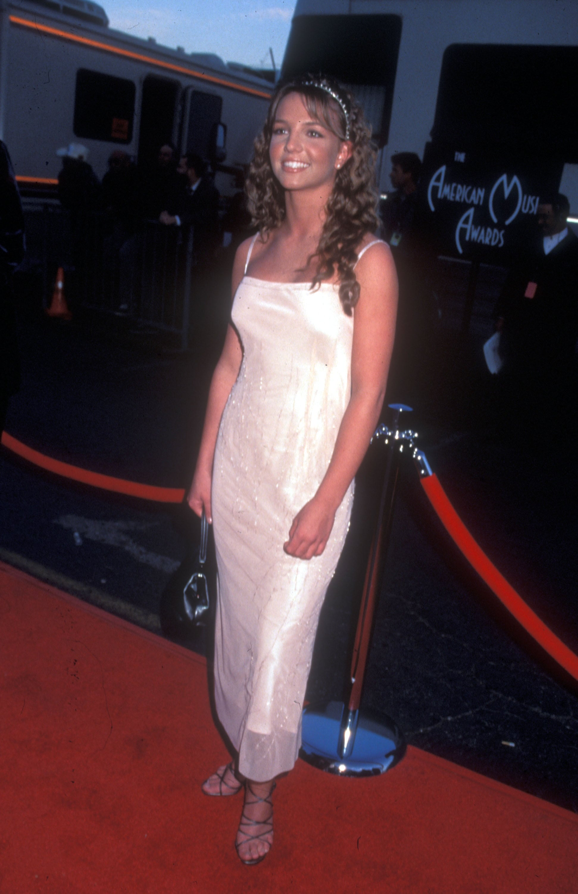 An innocent-looking Britney Spears posed on the red carpet in 1999.