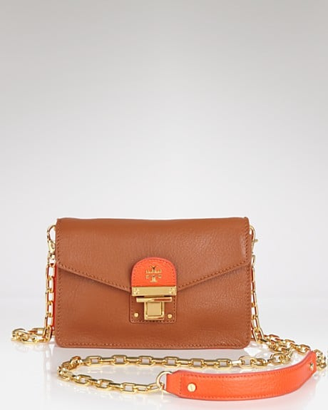 This wearable wallet has just enough room for your essentials like your cell phone, credit cards, and lip gloss.  Tory Burch Wallet Rachael Crossbody ($265)