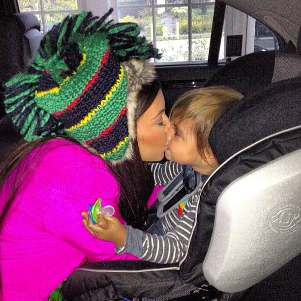 Kim Kardashian wore a funny hat and got a big kiss from Mason Disick.  Source: Instagram user kimkardashian