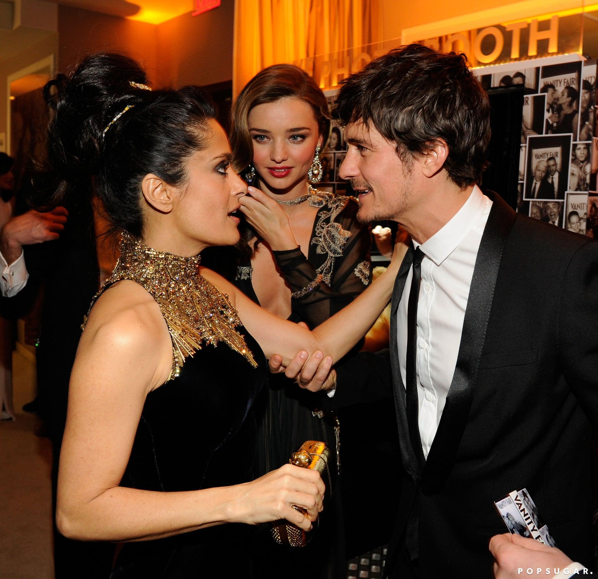 Salma Hayek greeted Orlando Bloom and Miranda Kerr at Vanity Fair's Oscar afterparty.