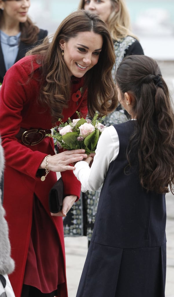 Kate Middleton visits with a young fan in Denmark.