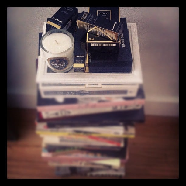 Alison's bedroom book tower comes complete with an armful of Chanel beauty products. Le sigh.