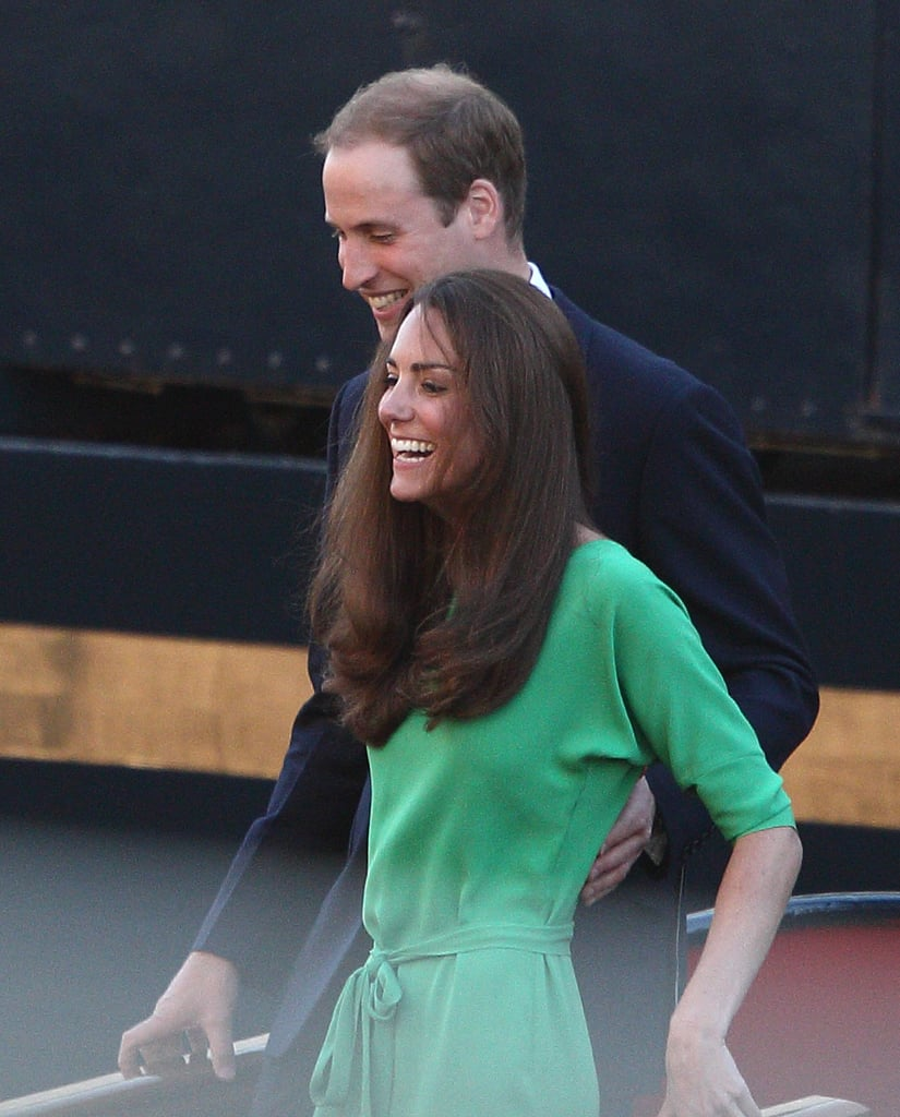 Kate Middleton and Prince William let out a laugh at the July 2011 prewedding festivities of Zara Phillips and Mike Tindall in Scotland.