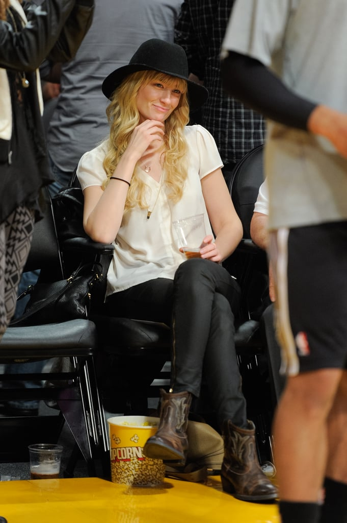 Things felt a little country for Beth Behrs in LA, where she watched a game in a simple black and white outfit accented by a pair of ankle-high boots that felt decidedly western.