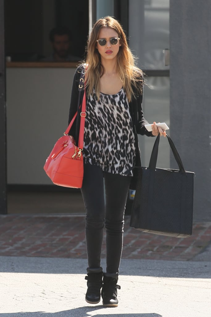 While running errands in West Hollywood, Jessica sported a leopard tank, Isabel Marant wedged sneakers, and her trusty Tory Burch Robinson tote.