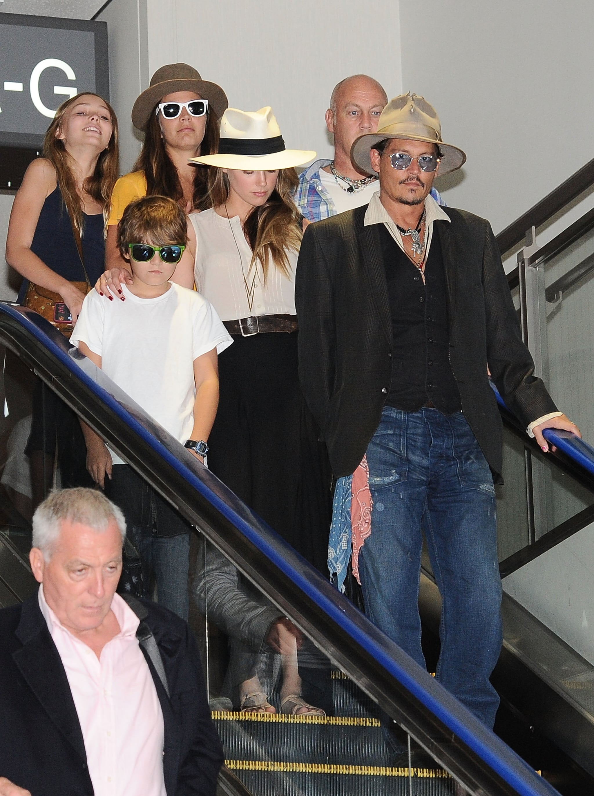Johnny Depp and Amber Heard left Tokyo with his children.
