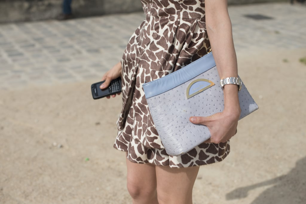 An oversize Dior clutch was made instantly better with this cool shade of lavender.