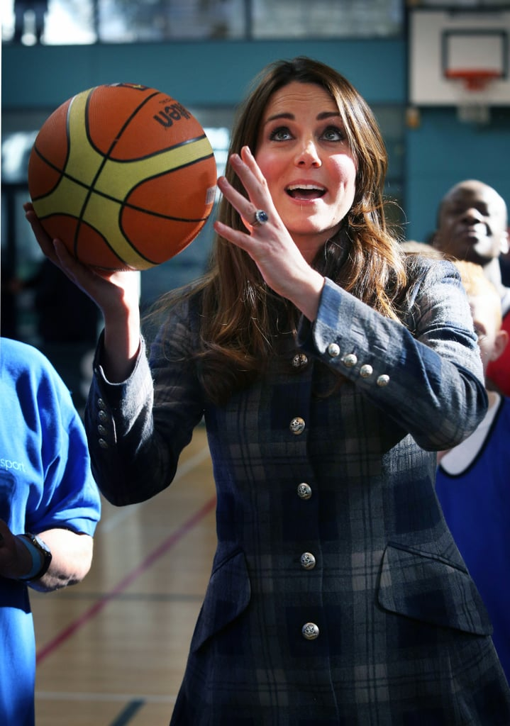 Pregnant Kate Middleton showed off her athleticism on the basketball court during a royal visit to Glasgow, Scotland, with Prince William.