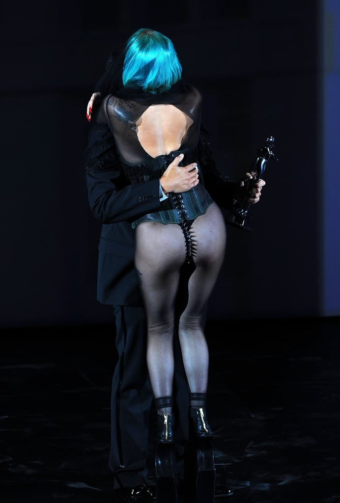 """Lady Gaga arrived at the CFDA Awards in a lace and beaded tulle skirt and 12-inch black platforms (apparently she dyed the outfit black from lime green just hours before). But when she got up to accept her Fashion Icon Award, Gaga had shed the skirt, revealing little more than a studded black bustier with a spiked thong in back. When Eric Wilson caught up with her later to ask how it felt to sit in a spiked thong all night, she replied, """"Feels good."""""""