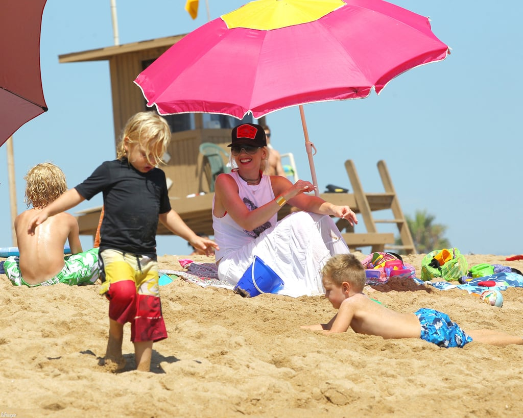 Gwen Stefani hit the beach under an umbrella while son Zuma ran around in the sand at Newport Beach in LA.