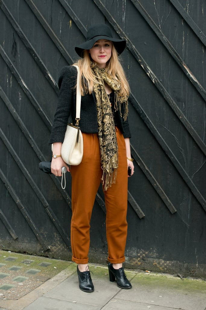 Trousers get a touch of bohemian whimsy with a floppy hat.