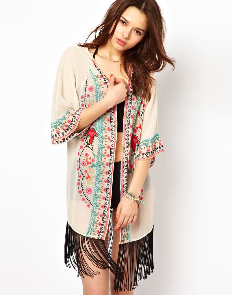 Something about this semi-sheer River Island Coachella Fringe Beach Kimono ($59) makes us want to sway from side to side and be one with the music.