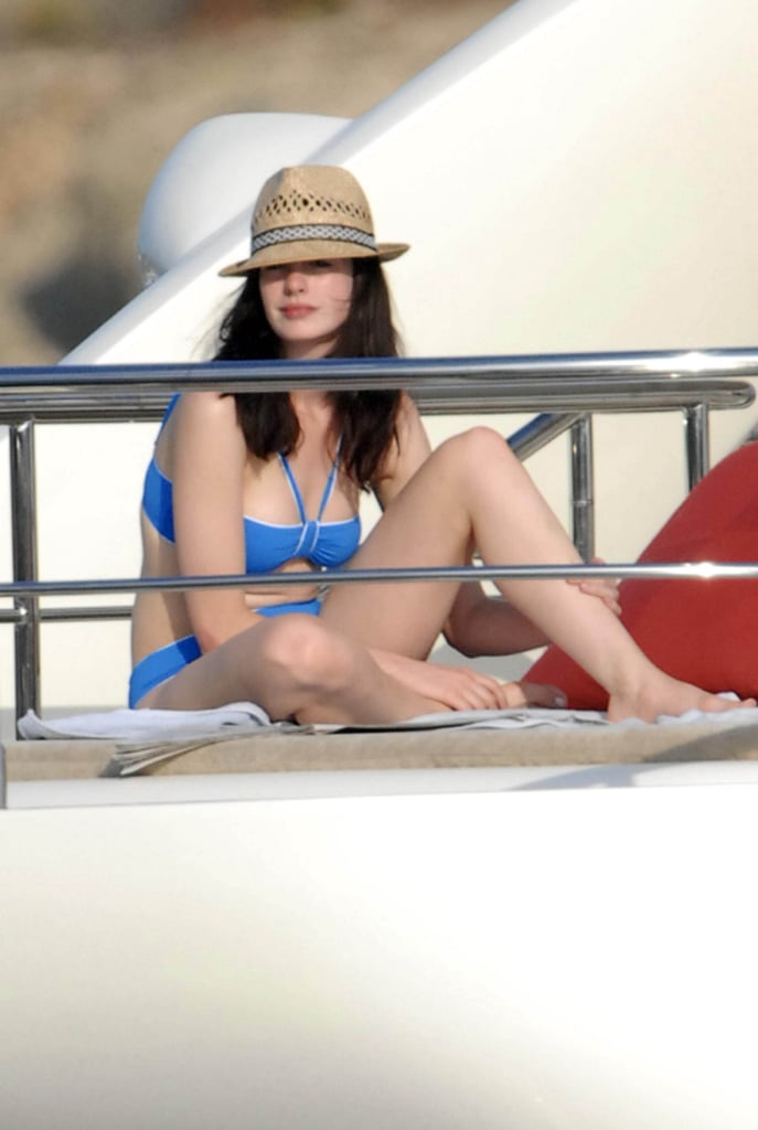 Anne Hathaway chilled in a blue bikini and straw hat during a trip to Portocervo, Italy in 2007.