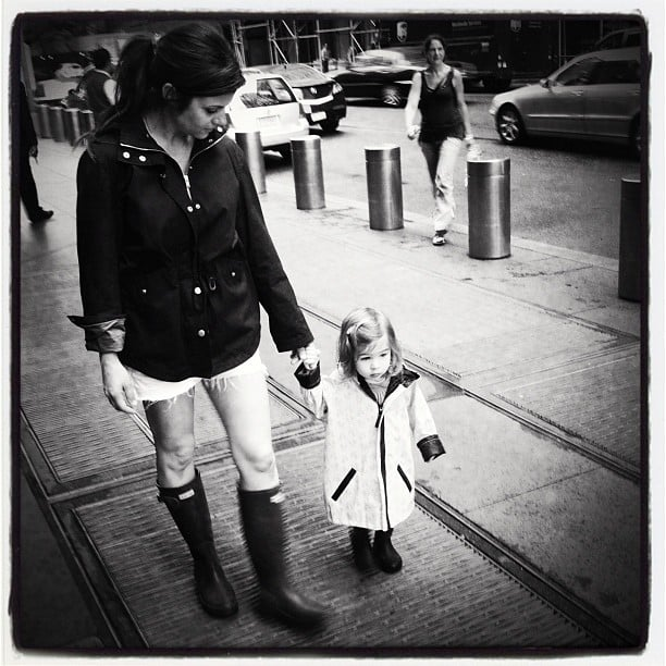 Tiffani Thiessen took a walk in the rain with her little girl, Harper. Source: Instagram user tathiessen