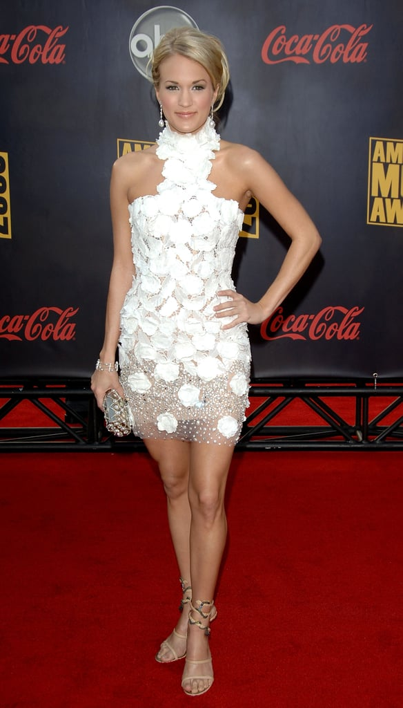 For the 2007 American Music Awards, Carrie exuded feminine flair in a floral appliqué Georges Chakra LWD. A high Victorian collar balanced the mini's sexy hemline.