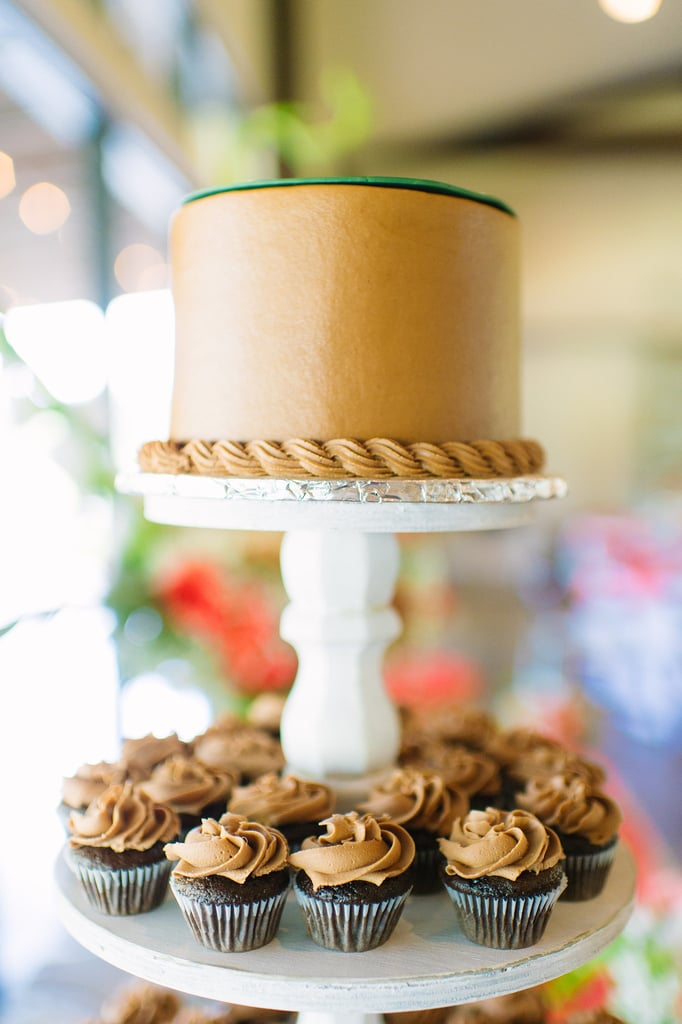 One-tiered cakes shouldn't be ruled out for your big day — this wedding proves that a classic cake can make an impact with a unique stand.