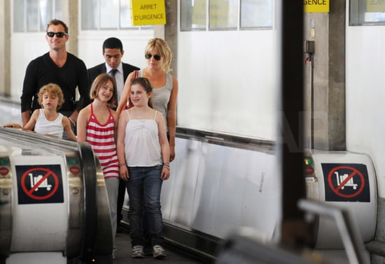 Pictures of Jude Law and Sienna Miller Arriving in Paris With His Kids Iris, and Rudy