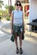 Alexa Chung showed off her impeccable style in a striped collared top, matching shorts, army shirt, and strappy flats. Source: Chi Diem Chau
