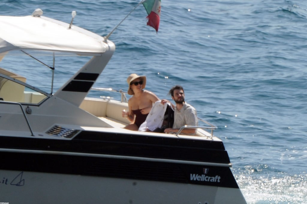 Tom Sturridge and Sienna Miller took a small boat to a yacht in Positano with baby Marlowe.
