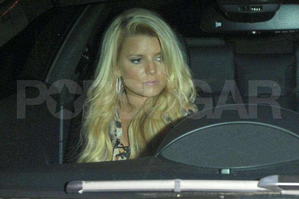 Jessica Simpson in the passenger's seat.