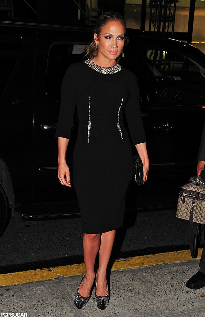 Jennifer Lopez wore a black dress with a shiny collar for a fundraiser in NYC.