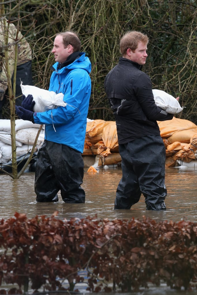 Prince William and Prince Harry got their hands dirty on Friday, when they set out on a private mission to help with the flood relief efforts in Datchet, England.