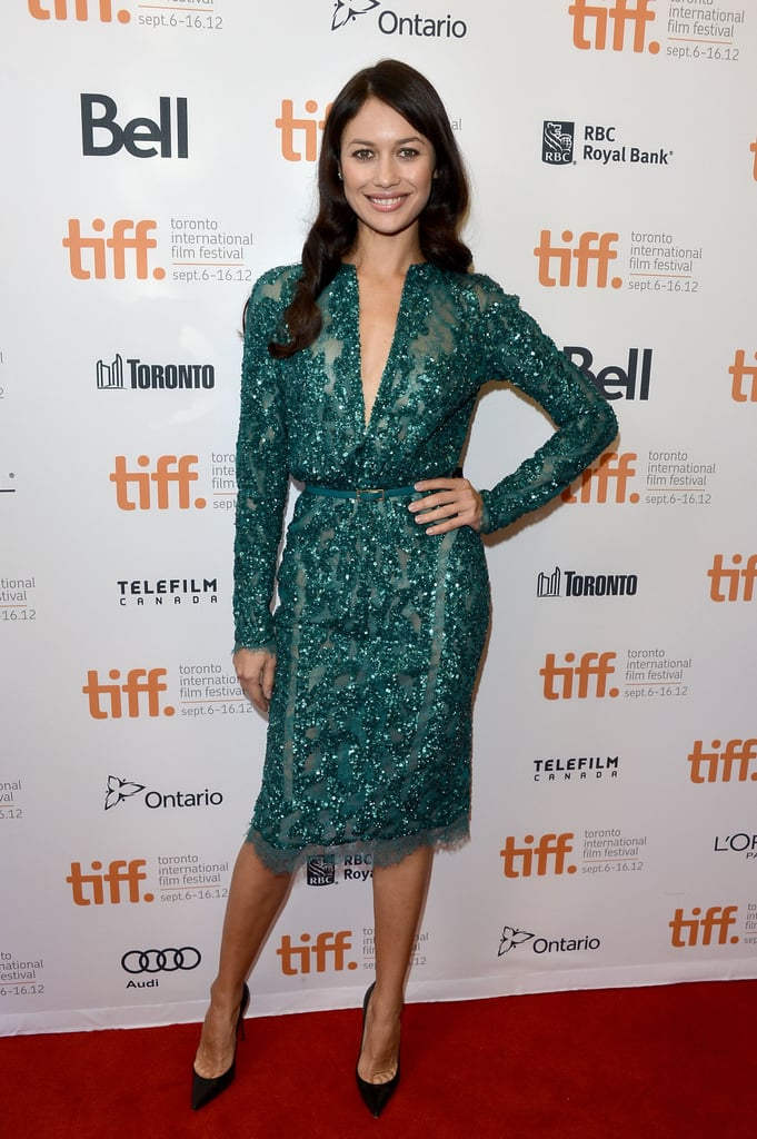 Rachel's costar Olga Kurylenko complemented her look with another green Elie Saab creation, this one super-embellished and a bit more cocktail hour-wearable.