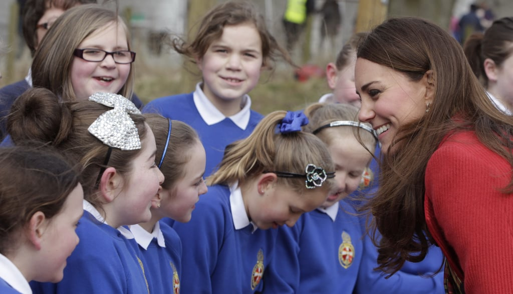 She laughed with a group of schoolchildren at the Dumfries House in Scotland in March.