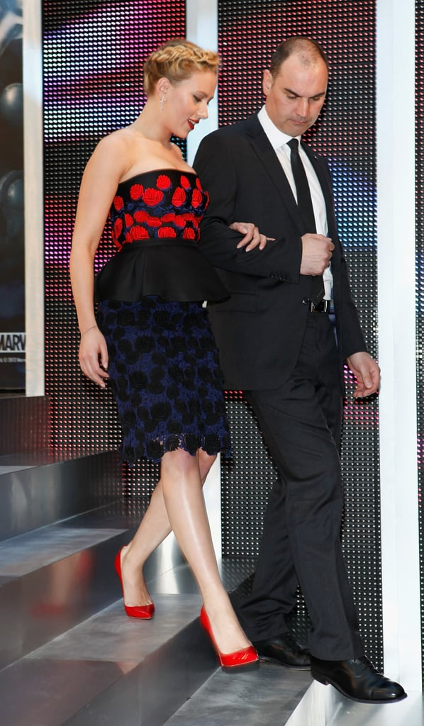 Scarlett Johansson was helped off the stage at the premiere of The Avengers in London.