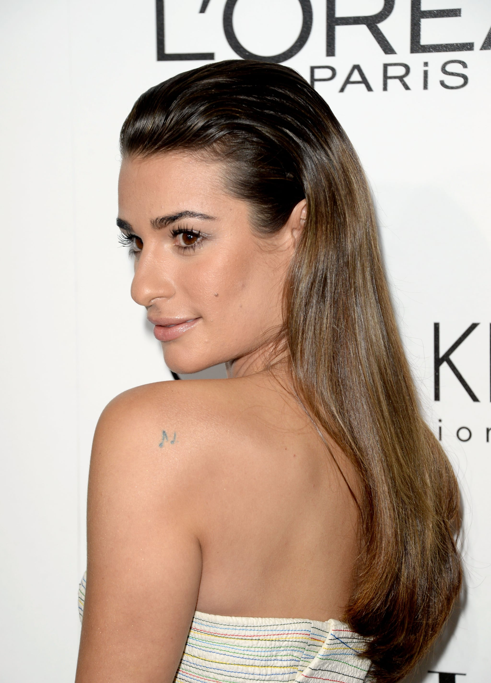 Lea Michele tried on the two-textured hairstyle seen so often on the runways, and with a bronzed makeup palette, this look screams Summer (which is only six months away). Use Visible Lift Color Lift Blush ($13) to get a similar glow.