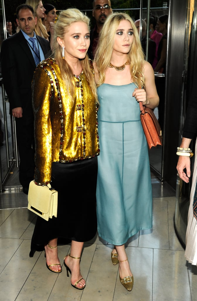 Twinning combo: For the 2011 CFDA Fashion Awards, both girls kicked it into high gear with high-shine pieces.  Mary-Kate donned an embellished gold Chanel topper, black high-low skirt, and pastel bag by The Row.  Ashley went a little more subtle in a sheen, baby-blue creation and burnt-orange crocodile bag, both by The Row, with metallic ankle-strap pumps.