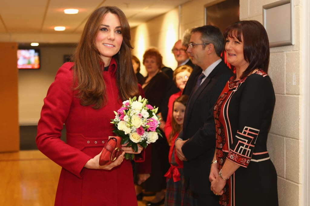 Kate Middleton received flowers from hosts at the rugby match.