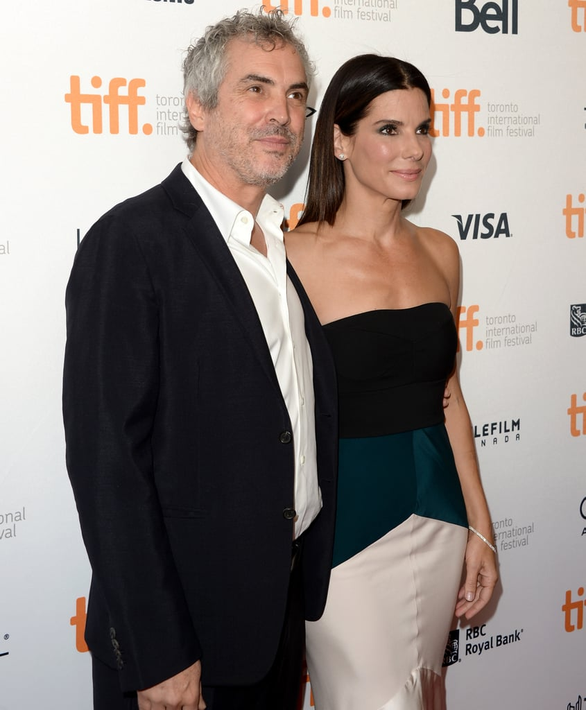 Sandra Bullock posed with director Alfonso Cuarón on the red carpet.