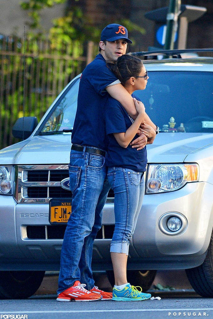Ashton wrapped his arms around Mila in NYC in September 2012.