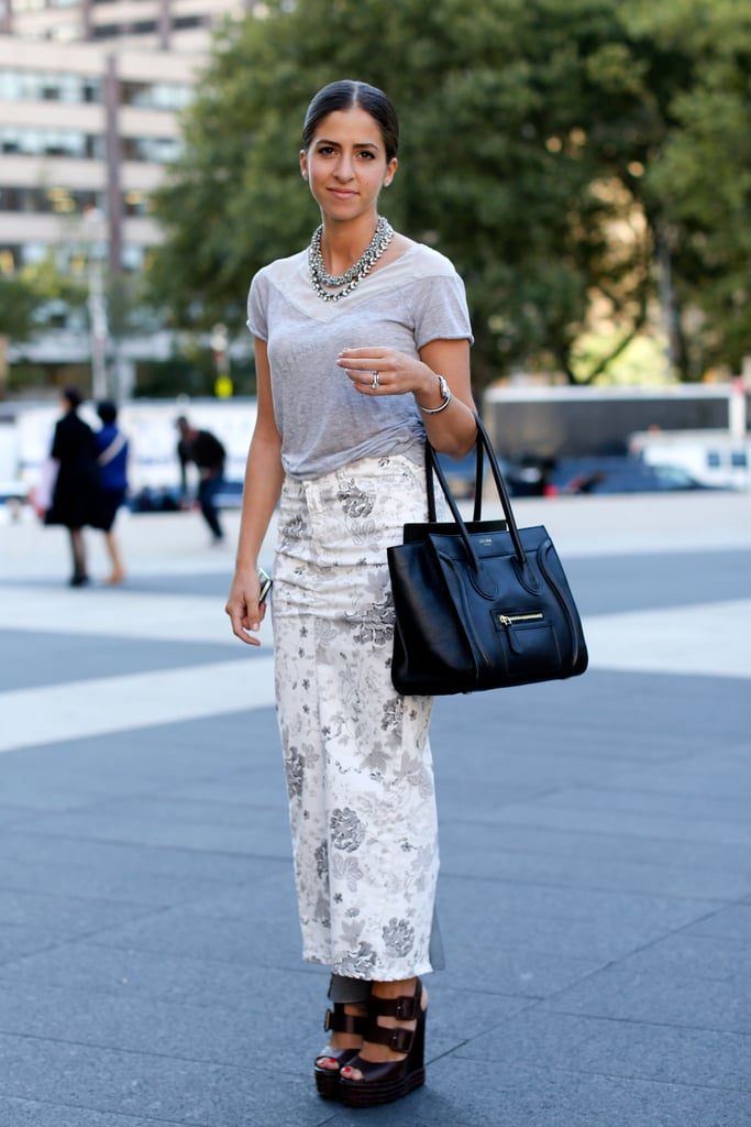 A full-length printed skirt gets a touch of luxe via a Céline tote and statement jewels.